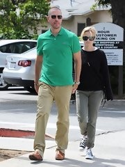 "Reese wore a pair of olive ""Inez"" low-rise slim fit pants while out with her husband for lunch."