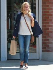 Reese Witherspoon smartened a plain white tee with a navy blazer with gold buttons for a day out in LA.
