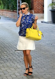 The eternally youthful Reese Witherspoon stepped out in Beverly Hills looking preppy in a blue Draper James print blouse teamed with a white mini skirt.
