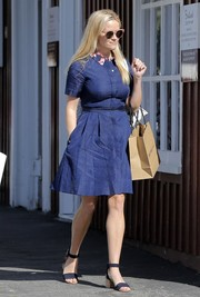 Reese Witherspoon went shopping looking cute and youthful in a navy Draper James shirtdress with a printed collar.