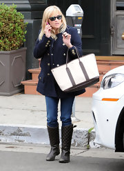 Reese Witherspoon kept her look classic with a military-style pea coat and two-tone tote.