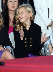 Looking at Ava's gold-buttoned pea coat and purple dress ensemble, it's obvious she got mom Reese's style gene.