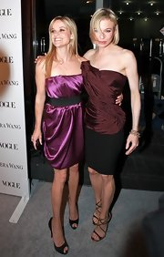 Renee completed her Vera Wang bustier and pencil skirt with metallic strappy evening sandals.