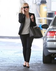 Reese Witherspoon dressed up a casual pair of pants with a simple black blazer.