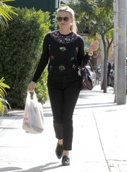 Reese Witherspoon looked chic in a colorful floral embellished top while running errands in West Hollywood.