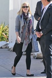 Reese Witherspoon added a pop of color to her casual look with a purple and pink patterned scarf.