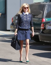 Reese Witherspoon completed her youthful, chic outfit with a blue mini skirt.