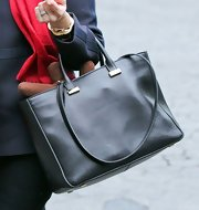 Reese Witherspoon stashed a pair of reindeer antlers in her black leather tote.