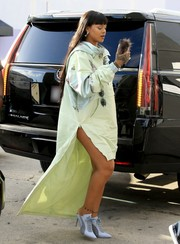 Rihanna showed off her unique style with this hooded mint-green mullet dress while visiting her Fenty x Puma pop-up store in LA.