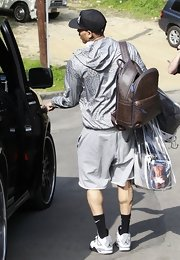 Chris Brown slung a luxe-looking brown leather backpack over his shoulder as he prepared to leave his house.