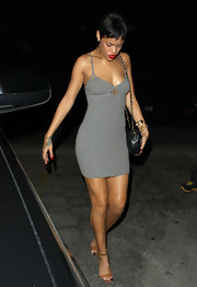 Rihanna went '90s-sexy in this simple gray mini with spaghetti straps.
