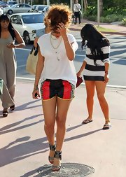 Rihanna matched the sport vibe of her short shorts with futuristic color-block sandals.