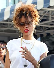 Rihanna wore her voluminous curls in ponytail while out and about in Miami.