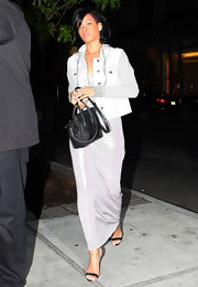 Rihanna stepped into a pair of strappy black sandals before heading out to dinner in NYC.