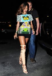 Rihanna rocked a pair of nude, over-the-knee gladiator sandals while out dining in NYC.