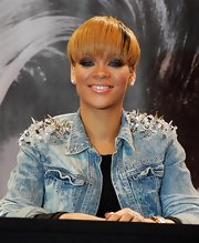 Rihanna dons her latest hairstyle, a short straight cut with highlighted bangs.