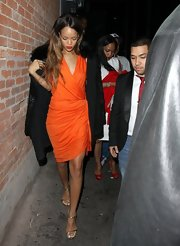 Rihanna spiced up Valentine's Day in this citrus orange faux wrap dress.