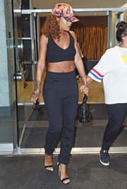 Rihanna was in skin-revealing mode, as usual, in a low-cut black crop-top while out in New York City.