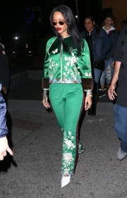Rihanna went for sporty elegance with this embroidered fur-cuff track jacket by Gucci for a day out in New York City.