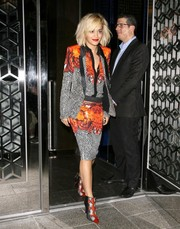 Rita Ora teamed her skirt suit with a pair of snakeskin ankle boots for a totally fierce look.