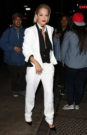 Rita Ora was masculine-chic in a white pantsuit teamed with a black button-down while out in New York City.