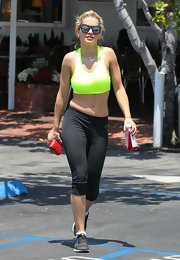 Rita Ora stepped out sporting a neon yellow sports bra while out in California.