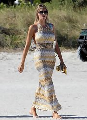 Rita threw on this chic print halter dress after a day on the beach in Miami.