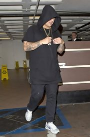 Rob Kardashian chose a tunic-style, short-sleeve hoodie for his going out look.