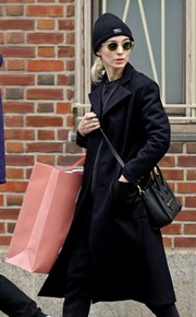Rooney Mara accessorized with a chic black leather bag by Celine while shopping in Manhattan.