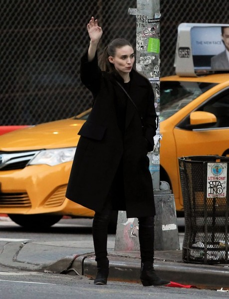 Rooney Mara sealed off her edgy ensemble with a pair of black ankle boots.