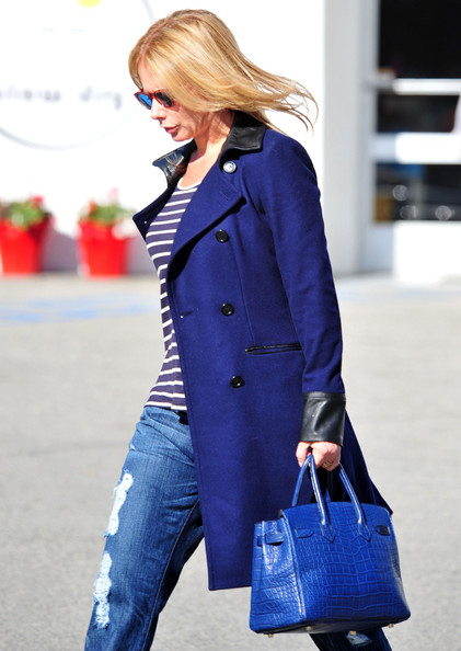Rosanna dons a blue wool coat with leather trimmings with this cute casual ensemble.
