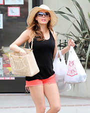 Rose Mcgowan's floppy straw hat was perfect for a lazy day around LA.