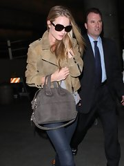 We love the warn-in look of Rosie's tan leather jacket. Timeless and edgy at the same time!