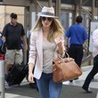 Rosie Huntington-Whiteley's Blush Blazer and Blue Jeans