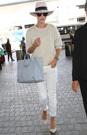 Rosie Huntington-Whiteley accessorized her airport outfit with a pale-blue leather tote by Balenciaga.