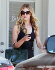 Rosie Huntington-Whiteley was spotted outside her gym looking chic in Givenchy butterfly sunnies.