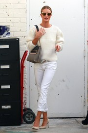 Rosie Huntington-Whiteley was spotted shopping wearing a white-on-white crewneck sweater and jeans combo.
