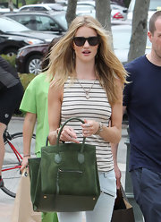Rosie Huntington-Whiteley toted her forest green bag with her semi-nautical look while having dinner in Malibu.