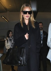 Rosie Huntington-Whiteley looked bold wearing these top-heavy Saint Laurent sunglasses as she arrived on a flight at LAX.
