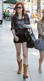 Rumer Willis went for a country vibe in a grungy flannel shirt and cowboy boots.