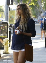 Ciara accessorized with a brown suede cross-body bag while out on an ice cream run.