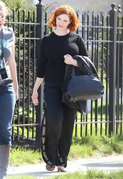 Christina Hendricks kept is comfy and casual on set with this black sweater.