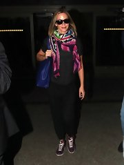 Emily Blunt brightened up her whole look with this patterned colorful scarf.