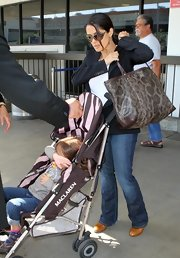 Salma Hayek paired her black blazer and jeans with a snakeskin textured tote bag.