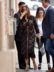 Salma Hayek teamed her dress with chic multi-strap sandals.