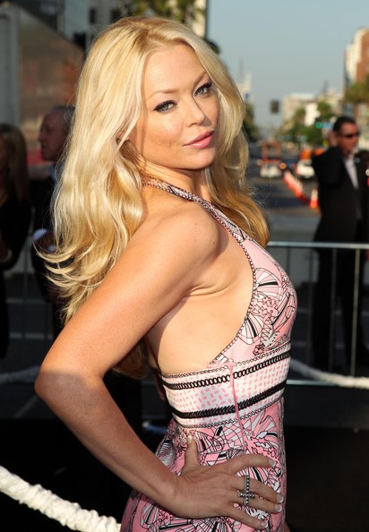 Charlotte Ross paired her hater print dress with long blonde curls.
