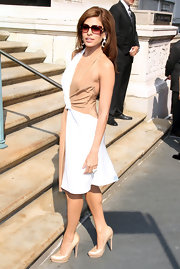 Eva Mendes looked elegant in a tan and white two-tone halter dress.