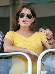 Princess Eugenie paired her yellow day dress with classic aviator sunglasses. The perfect look for a day at the Gold Cup.