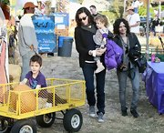 Allison Adler wore a medium curly haircut while out at the pumpkin patch with her family.