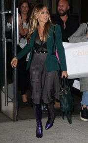Sarah Jessica Parker was spotted out in New York City looking chic in a black mesh-overlay midi dress by Philosophy di Lorenzo Serafini.